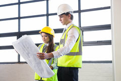 Architects looking at blueprint Royalty Free Stock Images