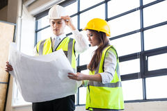 Architects looking at blueprint Stock Images