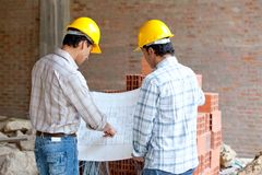 Architects looking at blueprints Royalty Free Stock Image