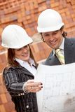 Architects looking at blueprints Royalty Free Stock Photography
