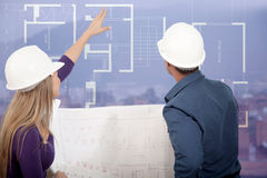 Architects looking at blueprints Stock Images