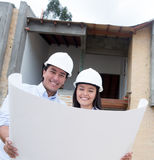 Architects looking at the blueprints Stock Images