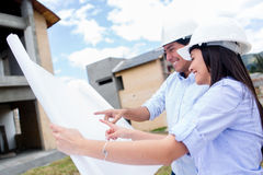Architects looking at the blueprints Royalty Free Stock Images