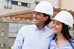 Architects looking at a house project Royalty Free Stock Photo