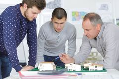 Architects looking at scale model housing development Stock Image