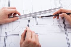 Architects making blueprint Stock Image