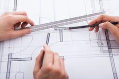 Architects making blueprint Stock Image