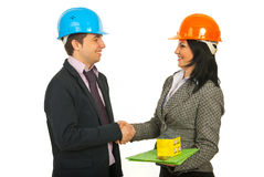 Architects making a deal. Two architects making a deal and shaking their hands isolated on white background Royalty Free Stock Photo
