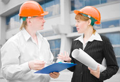 Architects man and woman  protective helmet Royalty Free Stock Photography