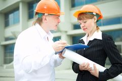 Architects man and woman  protective helmet Stock Image