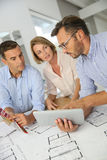 Architects meeting and discussing construction plans Royalty Free Stock Images