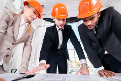 Architects next project. Three businessmеn architect  Stock Photo