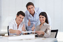 Architects in office holding thumbs Royalty Free Stock Photos