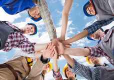 Architects piling hands against sky Royalty Free Stock Photography