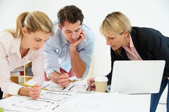 Architects Planning Layout Of Empty Office Space Royalty Free Stock Photos
