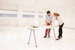 Architects Planning Layout Of Empty Office Space Stock Image