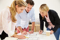 Architects Planning Layout Of Empty Office Space Stock Photos