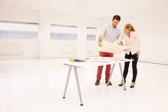 Architects Planning Layout Of Empty Office Space Royalty Free Stock Images