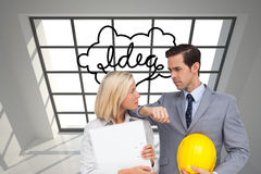 Architects with plans and hard hat looking at each other Stock Photo