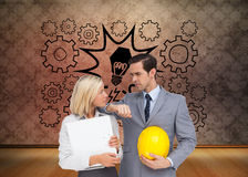 Architects with plans and hard hat looking at each other. Composite image of architects with plans and hard hat looking at each other Stock Images