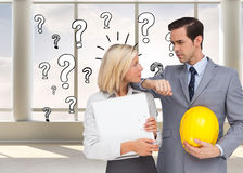 Architects with plans and hard hat looking at each other Stock Images