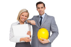 Architects with plans and hard hat Stock Images