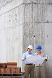 Architects Reading Blueprint At Site Stock Images