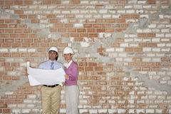 Architects Reading Blueprint At Site Stock Photos
