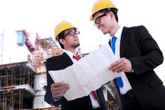 Architects Reviewing Blueprint Stock Photo