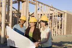 Architects Reviewing Blueprint Stock Photography