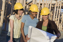 Architects Reviewing Blueprint At Construction Site Royalty Free Stock Image