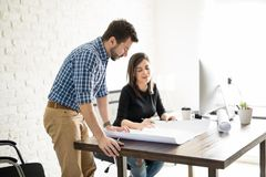 Architects reviewing some plans Royalty Free Stock Photo