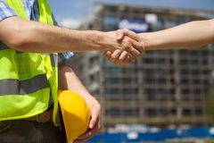 Architects shaking hand at construction site Stock Photography
