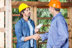 Architects Shaking Hands At Construction Site Royalty Free Stock Image