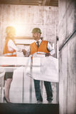 Architects shaking hands in office corridor Royalty Free Stock Images