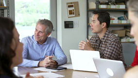 Architects Sitting Around Table Having Meeting stock video footage