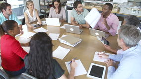 Architects Sitting Around Table Having Meeting stock footage