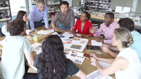 Architects Sitting Meeting Around Table To Discuss Materials stock video