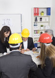 Architects sitting at table Royalty Free Stock Photography