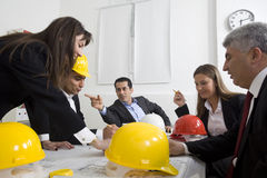 Architects sitting at table Royalty Free Stock Photos