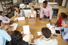 Architects Sitting At Table Meeting With Laptops And Tablets Royalty Free Stock Images