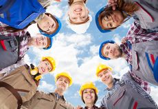 Architects standing in huddle against sky Royalty Free Stock Images