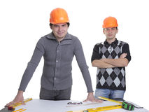 Architects standing over blueprints Royalty Free Stock Photos