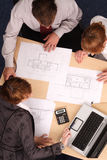 Architects studying plans Royalty Free Stock Images