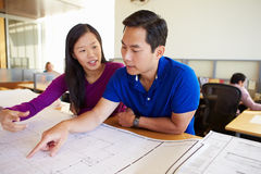 Architects Studying Plans In Modern Office Together Stock Photos