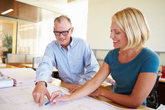 Architects Studying Plans In Modern Office Together Royalty Free Stock Image