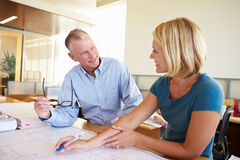 Architects Studying Plans In Modern Office Together Royalty Free Stock Photography