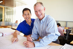 Architects Studying Plans In Modern Office Together.  Stock Images