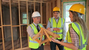 Architects talking about construction Stock Photo