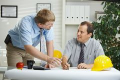 Architects talking at office royalty free stock photo